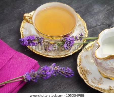lavender tea with milk jug over ardesia - stock photo