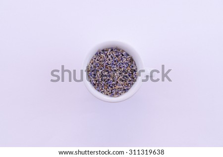 Lavender the image shows a lavender in a white porcelain bowl - stock photo
