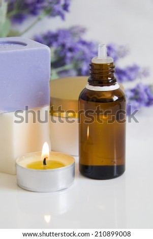 Lavenders Aromatic Candles,Soap,Cream and Massage oil in a Natural Spa  - stock photo
