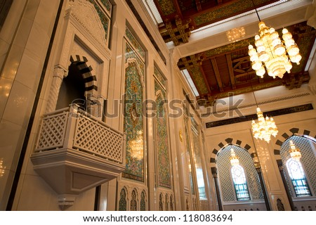 Lavishly decorated interior of the Sultan Qaboos Grand Mosque in Muscat, Oman, showing the main pulpit. - stock photo