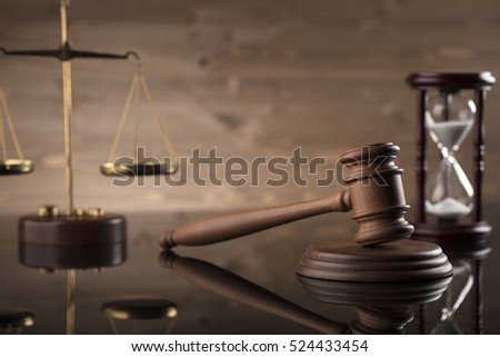 Law and justice concept. Brown wooden background beautiful reflections. Place for typography and logo.