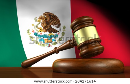 Law and justice of Mexico concept with a 3d rendering of a gavel on a wooden desktop and the Mexican flag on background. - stock photo