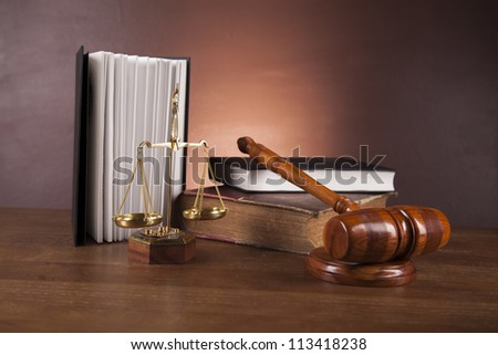 Law and justice stuff on wood table and dark background
