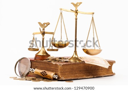 law book, magnifying glass and scales of justice isolated on white - stock photo