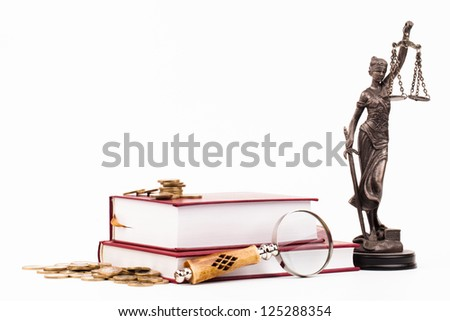 law books, magnifying glass and lady of justice - stock photo