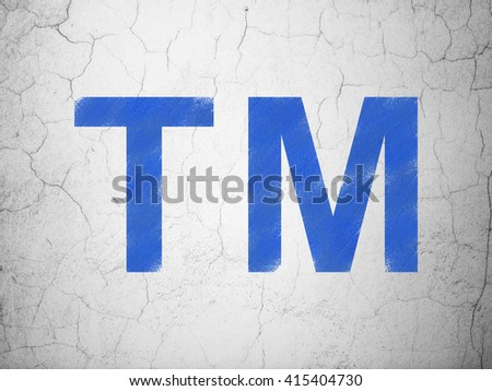 Law concept: Blue Trademark on textured concrete wall background - stock photo