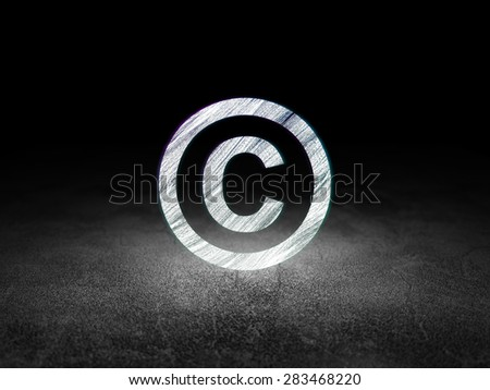 Law concept: Glowing Copyright icon in grunge dark room with Dirty Floor, black background, 3d render