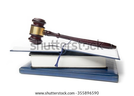 Law concept - Law book with a wooden judges gavel on table in a courtroom or law enforcement office isolated on white background. Copy space for text. - stock photo