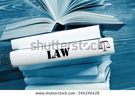 Law concept - Law book with Law word on table in a courtroom or law enforcement office. Toned image - stock photo