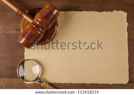 Law concept with wooden table and dark background