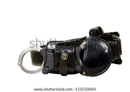 law enforcement black utility belt with handcuffs - stock photo