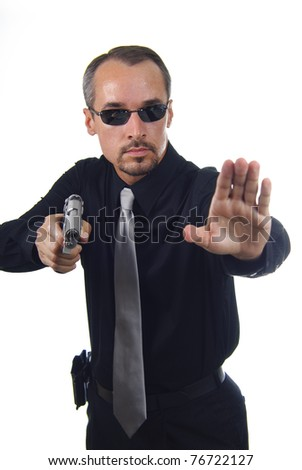 law enforcement officer with drawn gun using the stop motion with hand, shallow depth of field with focus face