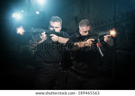 Law enforcement officers special tactics team in action