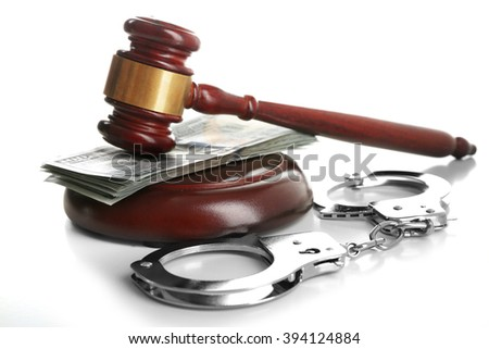 Law gavel with dollars and handcuffs isolated on white - stock photo