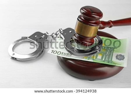 Law gavel with euro and handcuffs isolated on white - stock photo