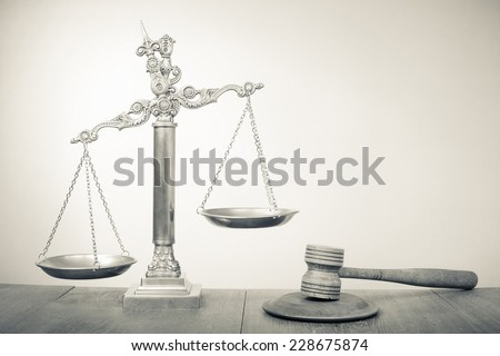 Law scales and wooden gavel - Symbol of justice. Vintage old style sepia photo - stock photo