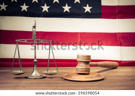 Law scales, judge gavel front USA flag. Symbol of justice - stock photo