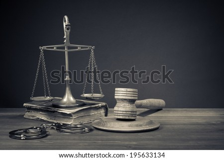 Law scales, judge gavel, old book, handcuff. Symbol of justice. - stock photo