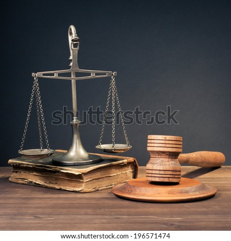 Law scales, judge gavel, old book. Symbol of justice - stock photo