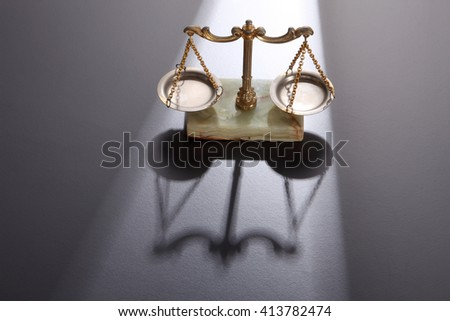 Law scales on gray background. Symbol of justice - stock photo