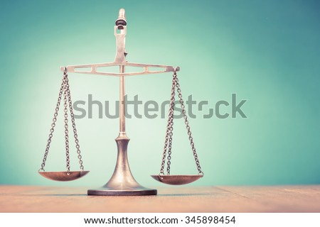 Law scales on table. Symbol of justice. Retro old style filtered photo