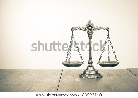 Law scales on table. Symbol of justice. Sepia photo - stock photo