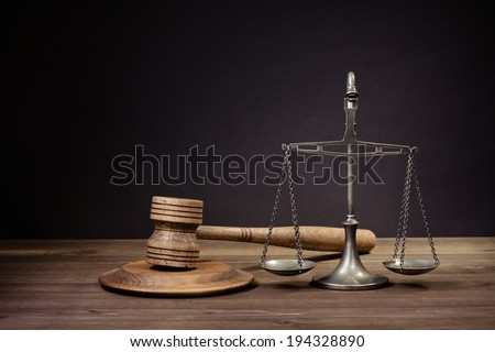 Law scales, wooden judge gavel. Symbol of justice. - stock photo