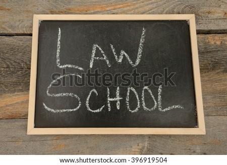 Law School written in chalk on a chalkboard on a rustic background - stock photo