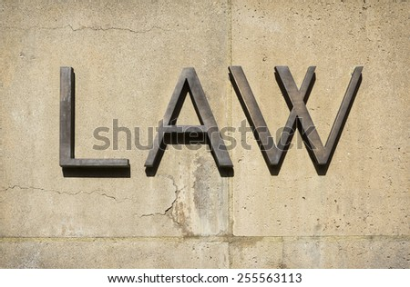 Law sign on a concrete wall