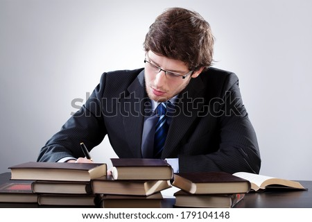 Law student working hard before an exam - stock photo