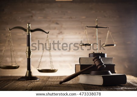 law theme, bronze and gold scales of justice, books, wooden mallet, statue of justice, books, on wooden table, studio shots