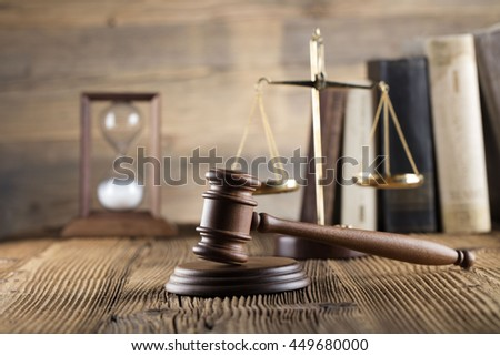 law theme, mallet of the judge, justice scale, hourglass, books, wooden desk