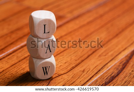 LAW word wooden blocks are on the floor. - stock photo