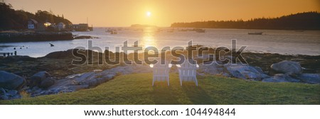 Lawn chairs at sunrise at Lobster Village, Tenants Harbor, Maine - stock photo