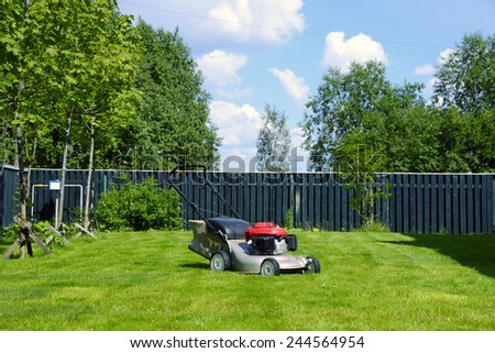 Lawn mover on a grass. - stock photo
