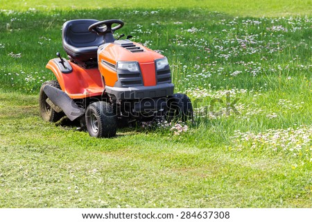 Lawn mower and cut green grass