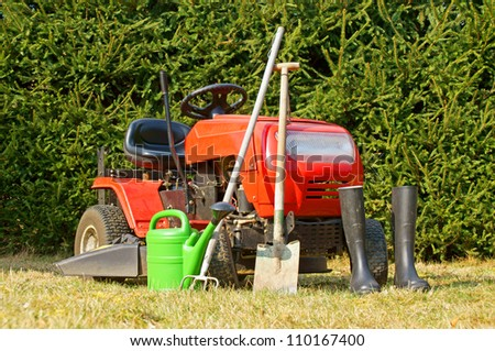 lawn mower and other garden tools / gardening - stock photo