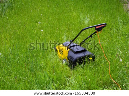 Lawn Mower in long grass