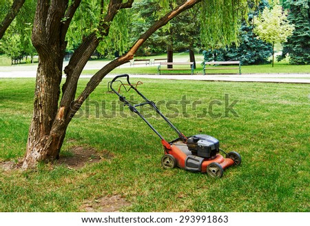 Lawn mower in the park on the grass