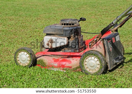 Lawn Mower On A Grass Field - stock photo