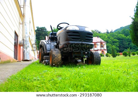 lawn mower on the grass - stock photo