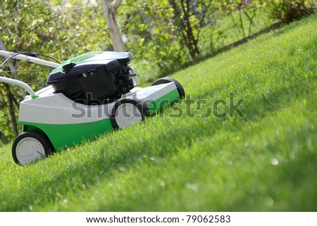 lawn mower on the lawn - stock photo