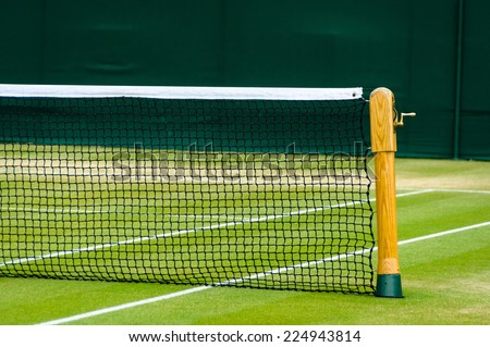 Lawn tennis court and net - stock photo
