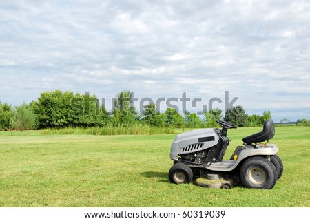 lawn with lawn mower - stock photo
