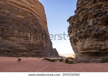 Lawrence of Arabia valley in Wadi Rum desert, Jordan. Wadi Rum, also known as The Valley of the Moon, is a valley cut into the sandstone and granite rock in southern Jordan 60 km to the east of Aqaba. - stock photo