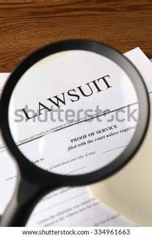 lawsuit magnified