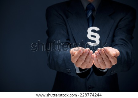 Lawyer (advocate, jurist) grant legal aid. Law represented by paragraph symbol. - stock photo