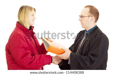 Lawyer gives the client some documents - stock photo