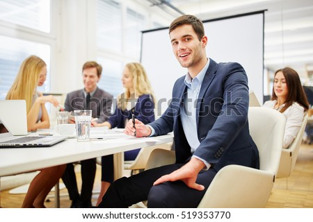 Lawyer has an idea in a business meeting and feels joy