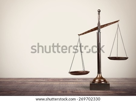 Lawyer. Law scales on table in front black background. Symbol of justice - stock photo